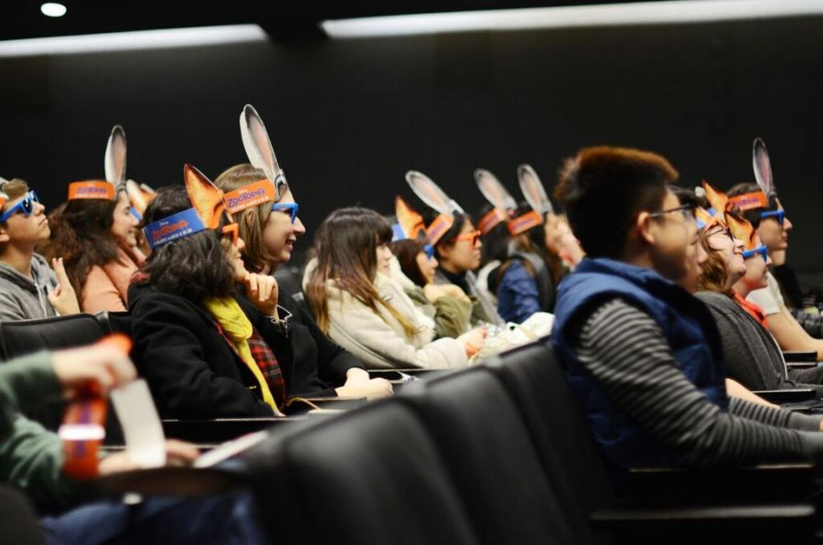 Students wearing Zootopia-themed masks enjoy a presentation by animator Darrin Butters at the Cantor Film Center on February 25.