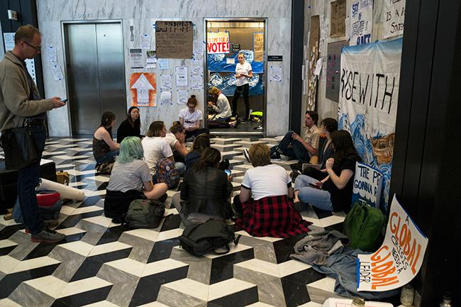 NYU Divest protesting in Elmer Holmes Bobst Library, April 18, 2016. NYU Divest is one of a number of groups which make up The Alliance for Justice at NYU, which is petitioning for NYU to divest from Aramark Corporation.