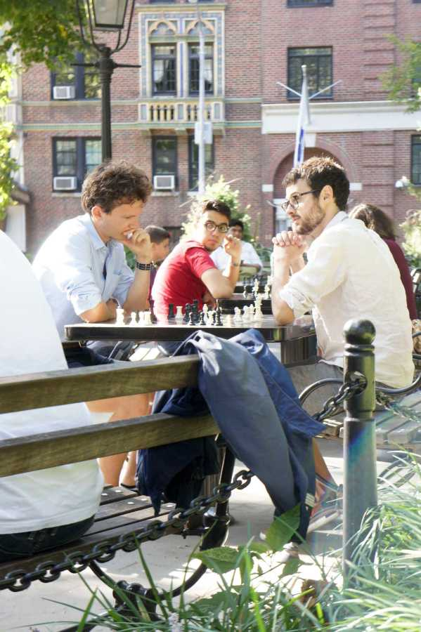 May 16th, Washington Square Park. A beautiful sunny day where several tables were occupied by chess players, concentration and focus is the key to win.