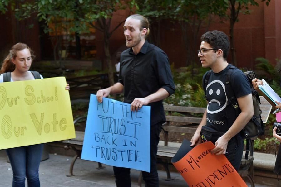Student activists gather outside of Bobst, where they remained chanting while organizers entered into the library to speak with the University representatives.
