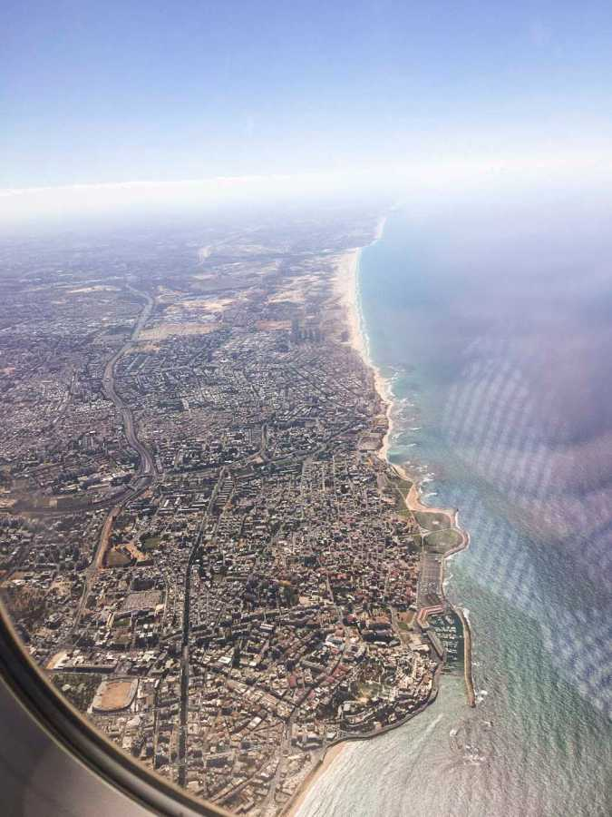 Prior to landing at his study away site, Tommy Collison takes an aerial shot of Tel Aviv and the Mediterranean.