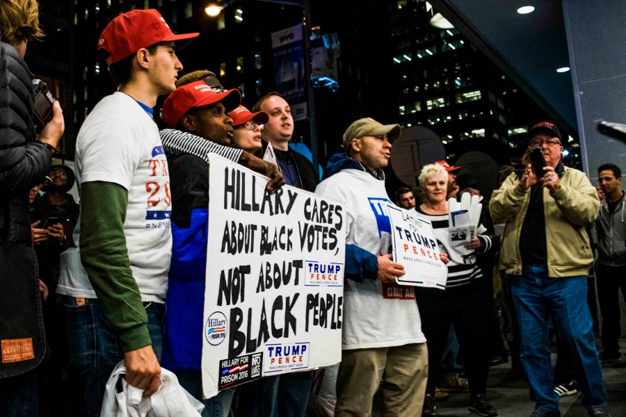 Trump supporters outside of the Hilton on the night of the Election with posters against Hillary.