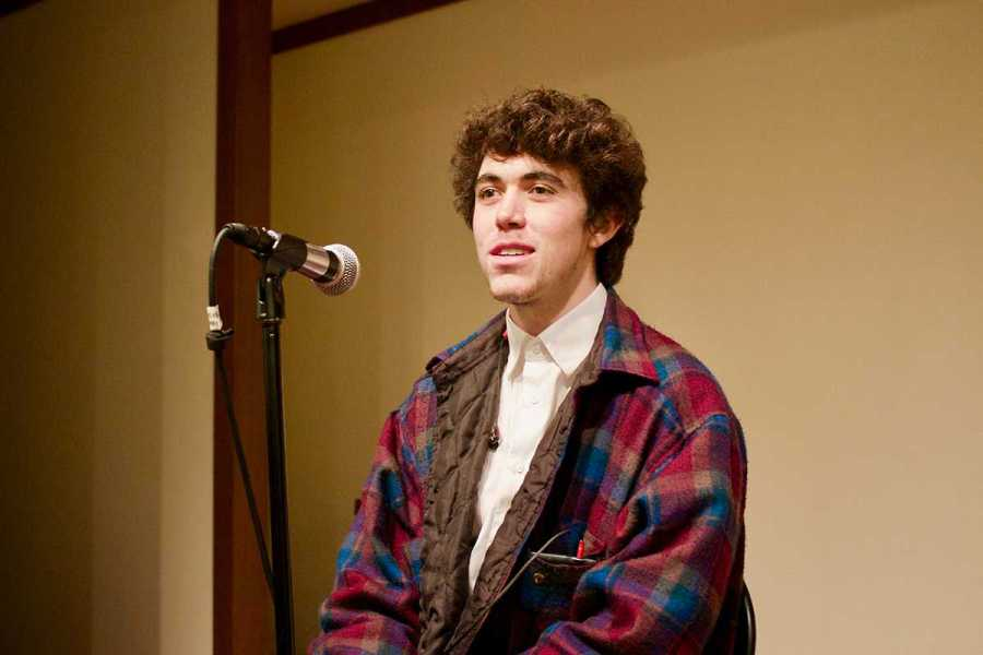 Hunter Thompson, a freshman in Gallatin, prepares his performance for the Coffeehouse Open Mic Night