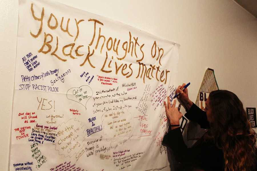 The Black Lives Matter art show presents an interactive art wall at the Living Gallery in Brooklyn