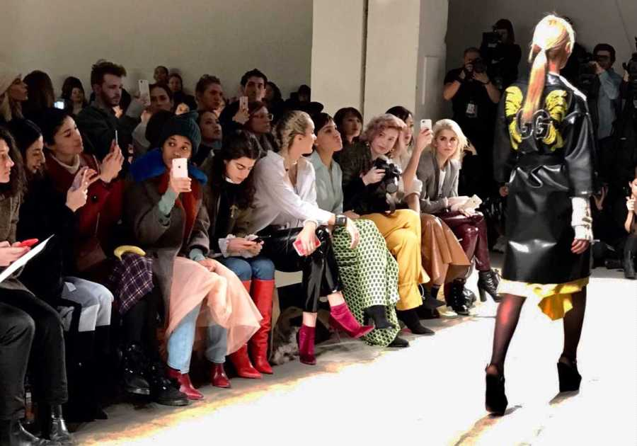 Fashion influencers view fashion week through the lens of their iPhones.