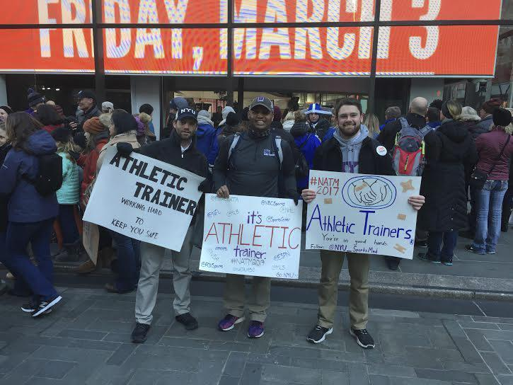 WSN profiles Arturo Flores, pictured in the center, who is an athletic trainer at NYU. He has been surrounded by sports his entire life and continues to be active even outside of NYU.