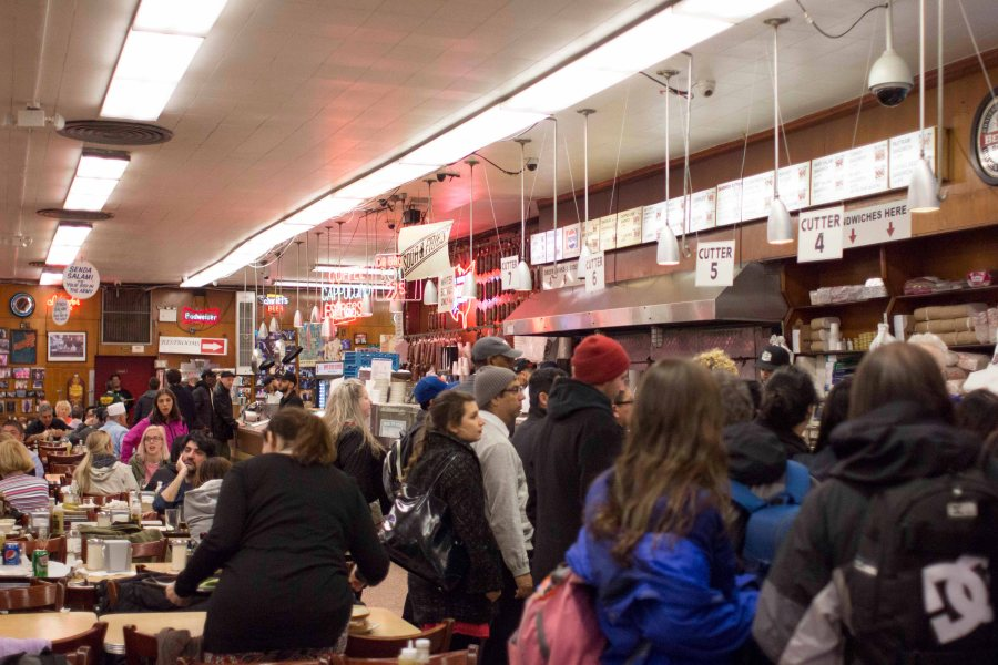 Katz Delicatessen is a famous deli on the Lower East Side that was brought over by Jewish immigrants. The menu includes classics like pastrami sandwiches and matzo ball soup, along with some unconventional options like tongue sandwiches and chopped liver.