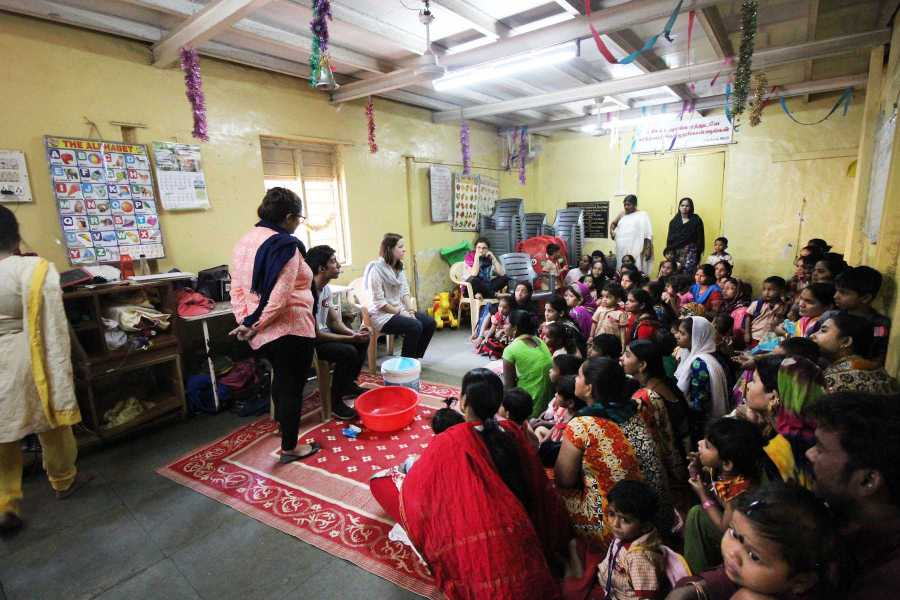 CAS+senior+Darshan+Mahabare+teaches+a+classroom+of+children%2C+mothers%2C+teachers+and+social+workers+in+Mumbai+how+to+wash+their+hands.+Mahabare%2C+alongside+Kanyon+Iwami%2C+is+a+representative+of+KickToChange%2C+an+organization+that+raises+funds+by+teaching+soccer+in+order+to+provide+hygiene+kits+for+communities+that+need+it.+