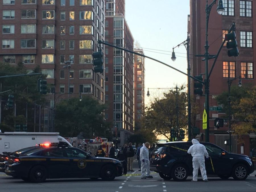 A recent attack on civilians in lower manhattan has left at least eight dead and 11 injured. Forensics and police gather to investigate and control the scene.