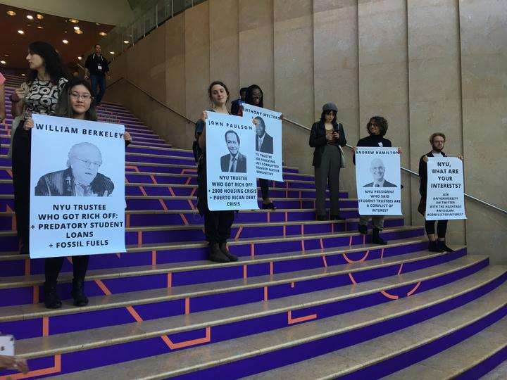 NYU SLAM members made posters outlining how members of the board have ties to other industries that could be deemed a