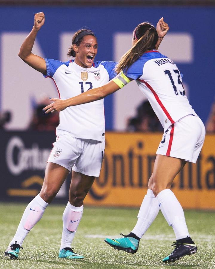 US women's soccer team players Lynn Williams and Alex Morgan celebrate after a game in North Carolina.