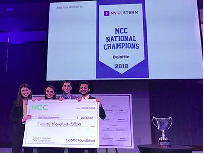 Team members Denitsa Kosharova, Eric Gioseffi, Utkarsh Satyawadi and Kelly Williams accepting $20,000 scholarship following first place win at the MBA Case Competition hosted by Deloitte University. The Stern MBA students earned the school its first victory in the competition.