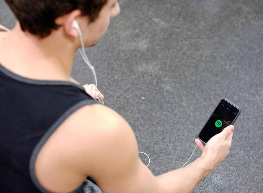 An athlete in the Palladium Athletic Facility opens the Spotify app before a workout.