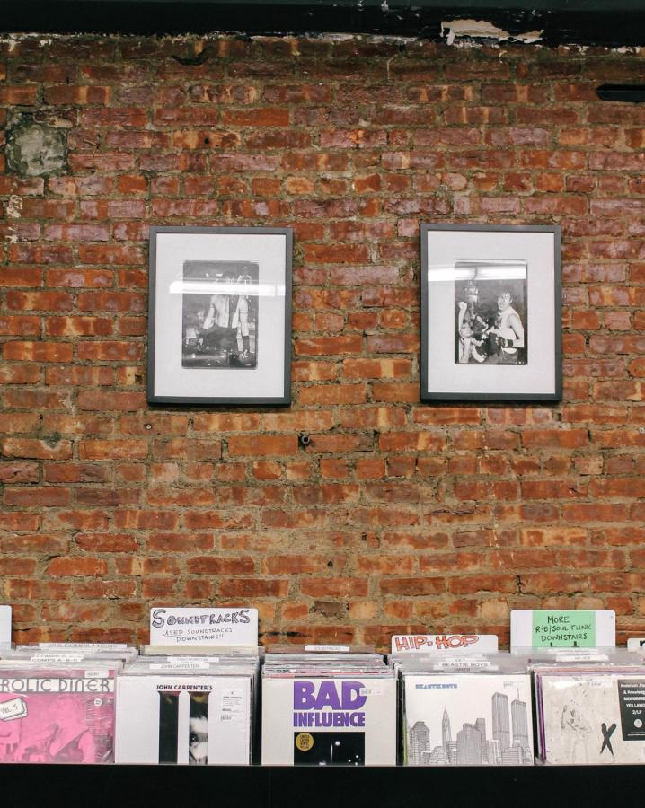 Interior wall decor and records on display.