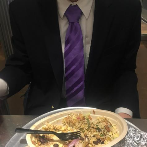 """Alex, a Stern student, eating at a Chipotle after a recruitment interview. It was one of the handful of times last month that he ate out, citing the """"caloric value"""" of Chipotle as an important factor in his decision."""