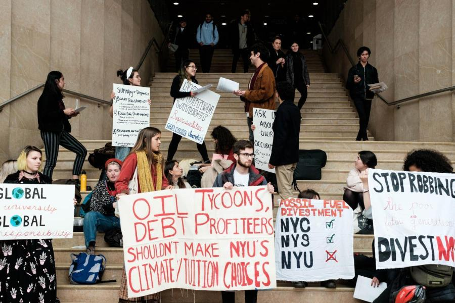 Protestors from SLAM and NYU Divest occupy the staircase of the Kimmel Center for University Life on March 28.