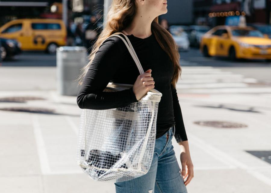 An+NYU+student+carries+a+clear+handbag+from+Urban+Outfitters.