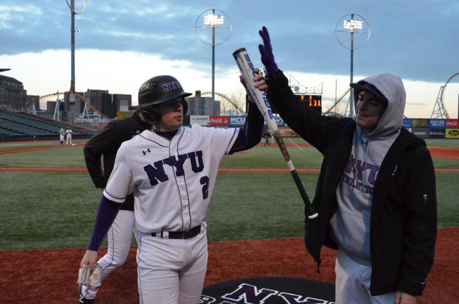 Players+high-five+at+a+baseball+game+at+MCU+Park.