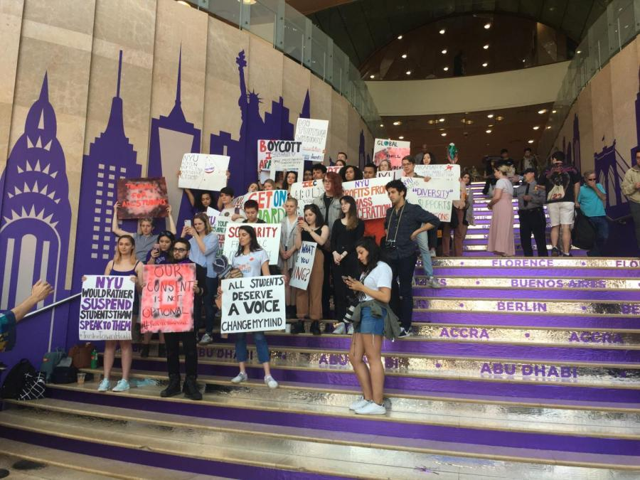 Prospective students and their guests walk up and down the steps of the Kimmel Center of University in the midst of activists protesting for a town hall meeting with trustees.