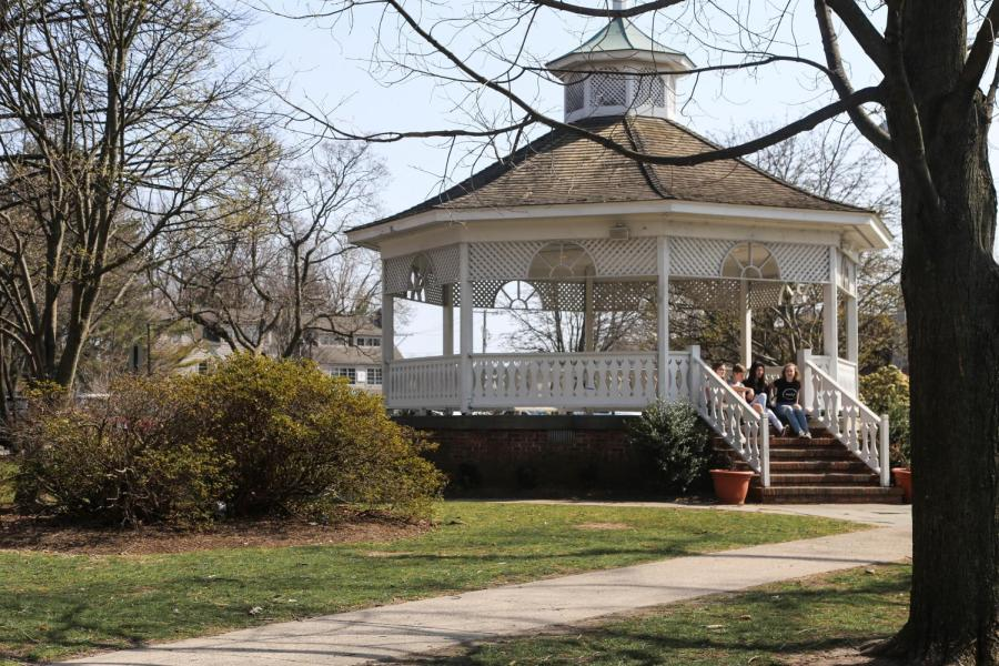 A gazebo on a grassy field is a popular spot for locals to picnic.