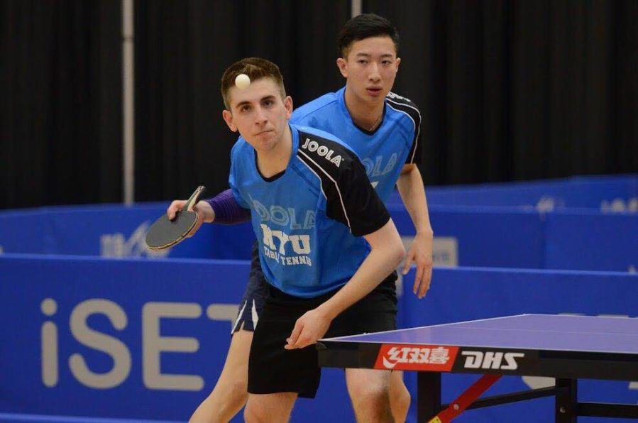 Adar Alguetti (front) and Yijun (Tom) Feng play doubles at the 2018 iSET College Table Tennis National Championships.