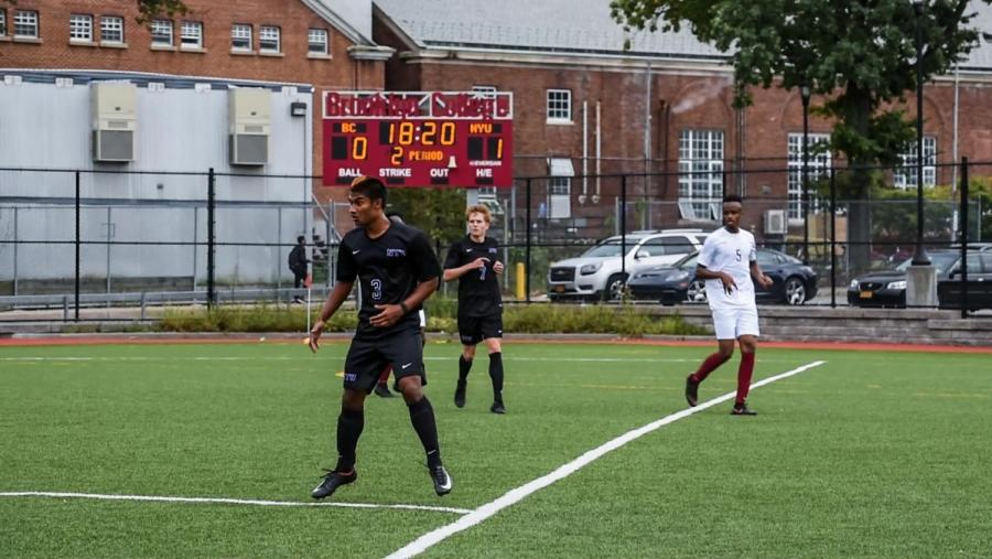 Richie Rambarran (front) scored one of NYU's goals in a 3-0 victory over Brooklyn College on Sept. 22.
