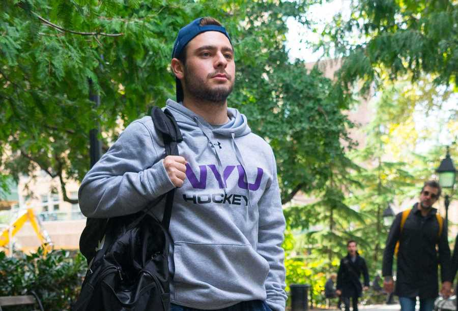 Sophomore Jake Drucker plays hockey for NYU, but his path to get there included a tumor and the death of his father. (Photo by Alana Beyer)