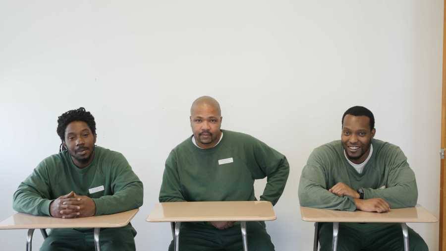 Bruce Mobley (far right) and two of his classmates in the Prison Education Program.