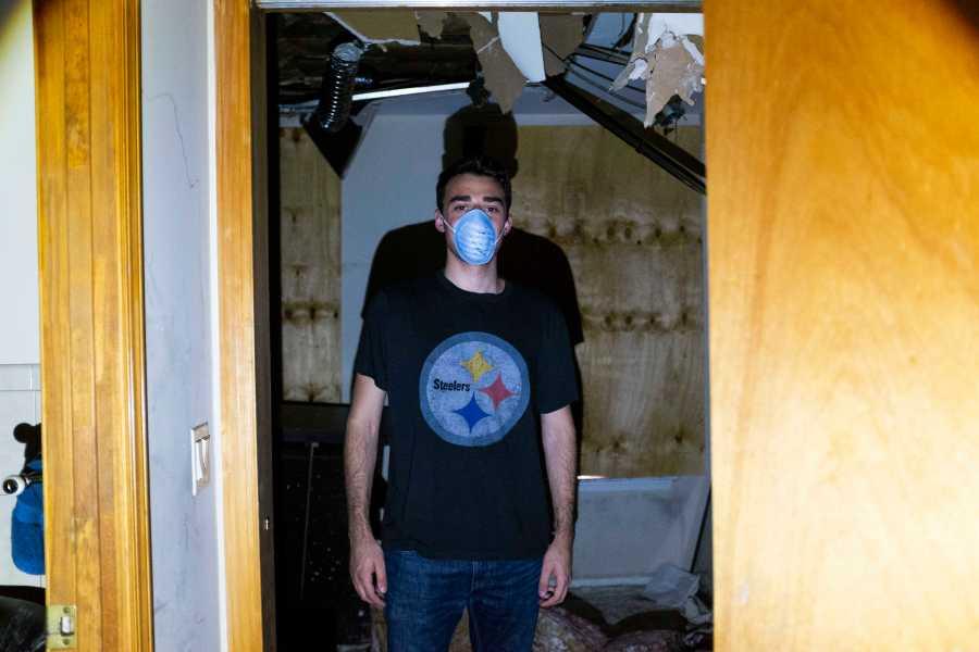 Spitzer stands in the doorway of his roommate's room. (Photo by Katie Peurrung)