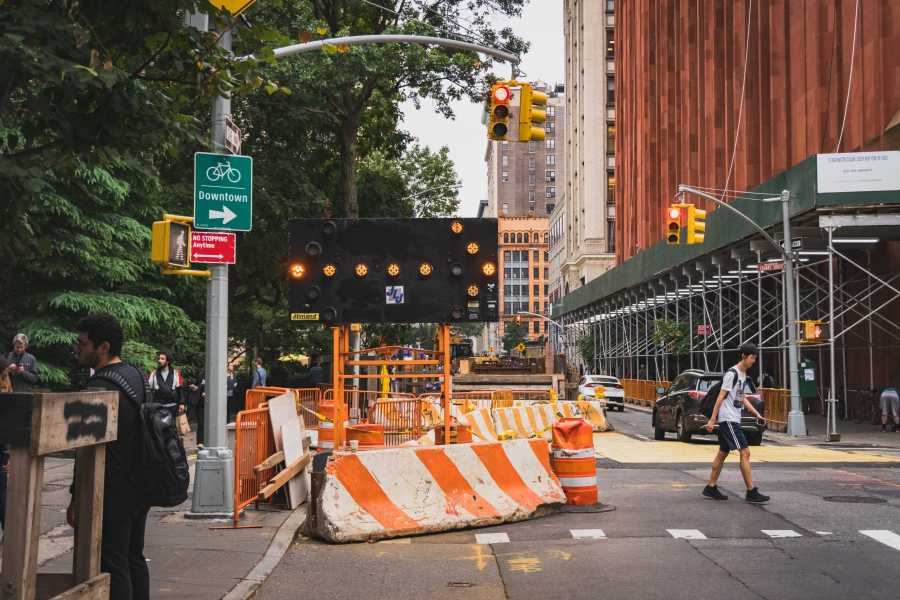 The ongoing construction on West 4th Street near Washington Square Park has reduced reduced free space for pedestrians. (Photo by Tony Wu)