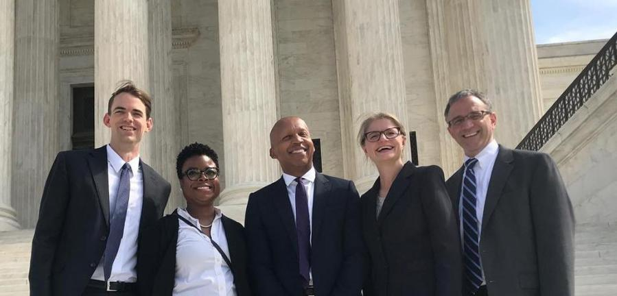 NYU Law Professor Bryan Stevenson (middle) surrounded by colleagues on steps of the Supreme Court. (Courtesy of Equal Justice Initiative)