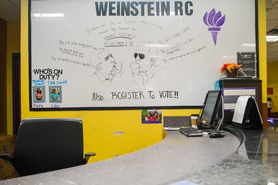 A reminder for students to vote in the midterm written on a whiteboard at the RC in Weinstein. (Photo by Alana Beyer)