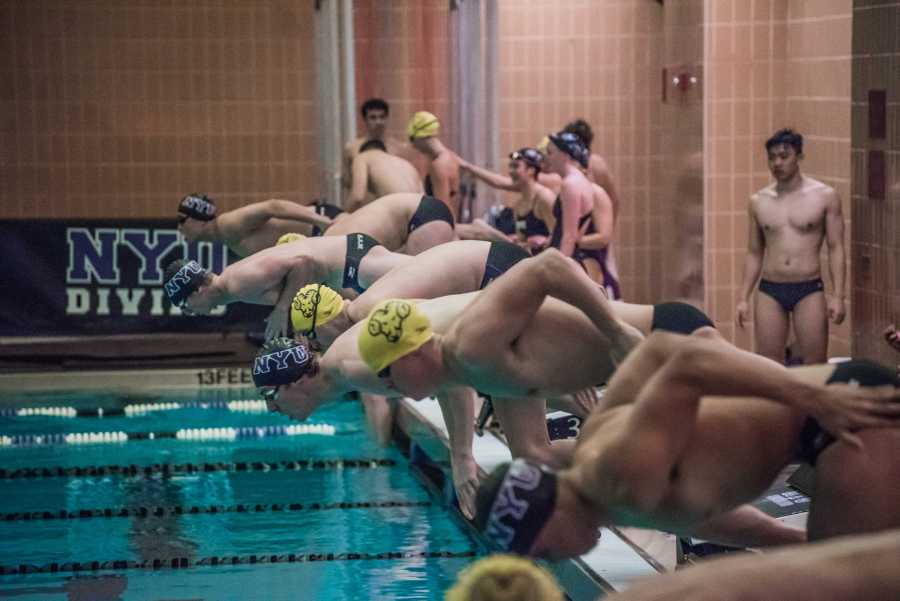 NYU+Swimmers+during+a+meet+on+Oct.+6.+First-year+swimmer+Graham+Chatoor+set+conference+and+NYU+records+to+earn+national+berths+in+the+1650-yard+and+500-yard+freestyle.+%28Photo+by+Sam+Klein%29