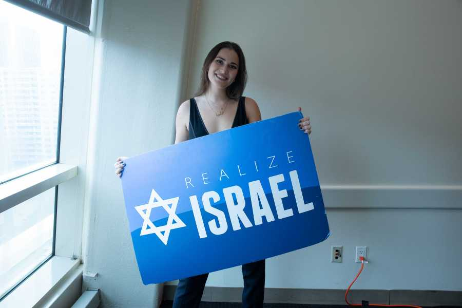 Adela Cojab, President of Realize Israel, at the event her club organized with Chief Political Correspondent for the Jerusalem Post, Gil Hoffman. (Photo by Alina Patrick)