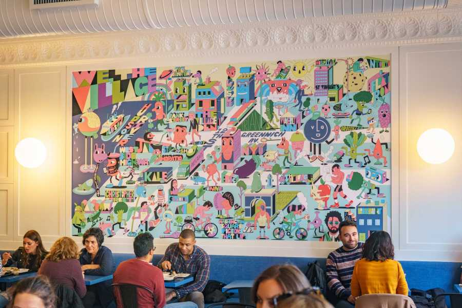 """The new mural in The Village Den. Lisle Richards says """"the new one is a nod to the old Village Den."""" (Photo by Tony Wu)"""