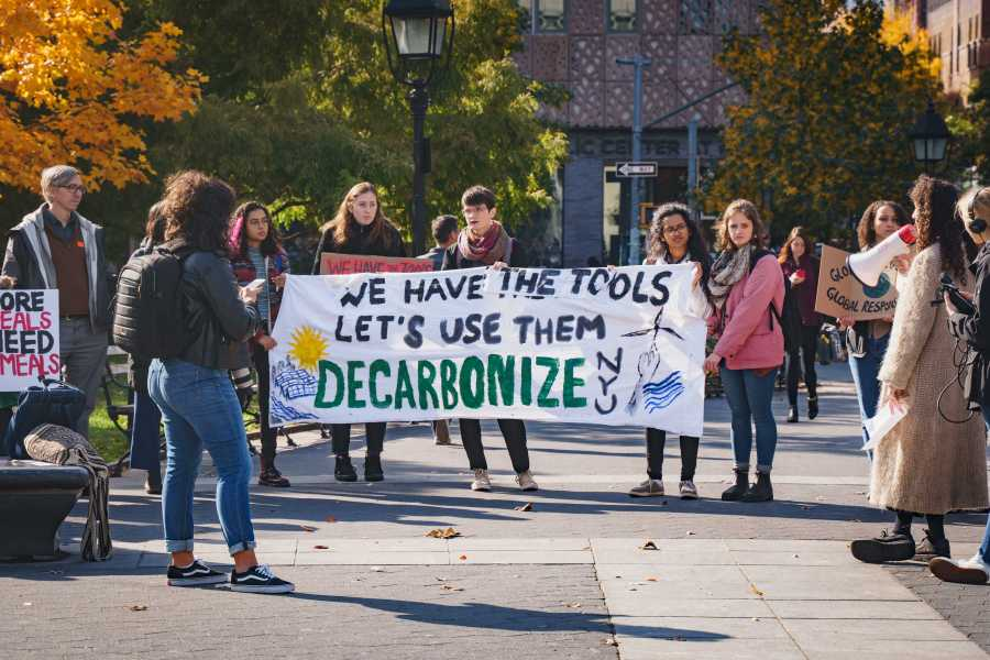 Students from NYU Divest called for the university to become carbon neutral at protests on campus last year. (Photo by Tony Wu)