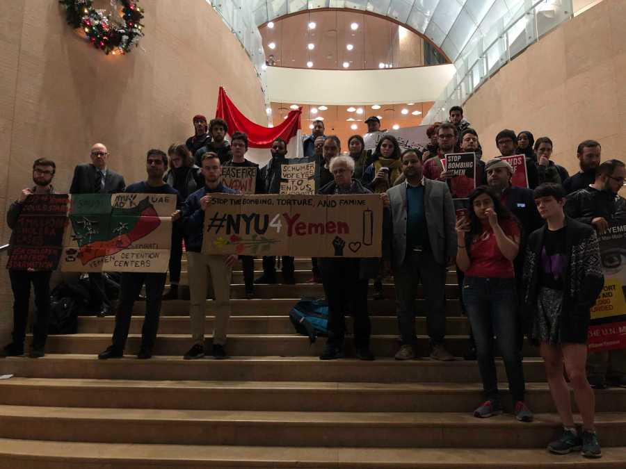 40 protestors on the steps of Kimmel protesting NYUs silence on conflict in Yemen. (Staff photo by Jared Peraglia)