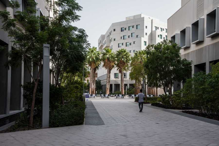 A student walks through the NYU Abu Dhabi Campus. NYU spokesperson John Beckman recently made a statement regarding the campus, which has been at the center of controversy during its decade of existence.  (Photo by Sam Klein)