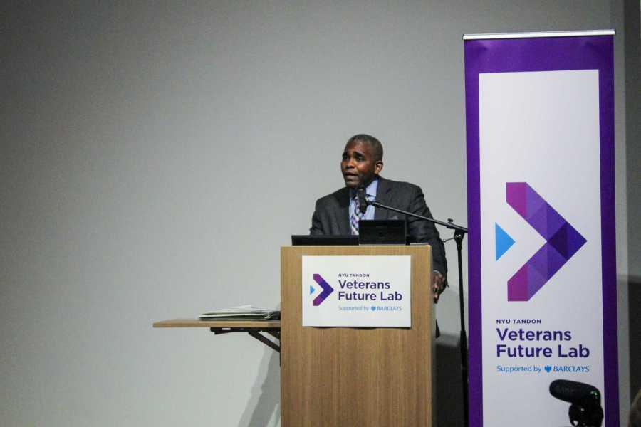 Director of the Veterans Future Lab James Hendon congratulates graduates of a 12-week entrepreneurship program. (Photo by Victor Porcelli)