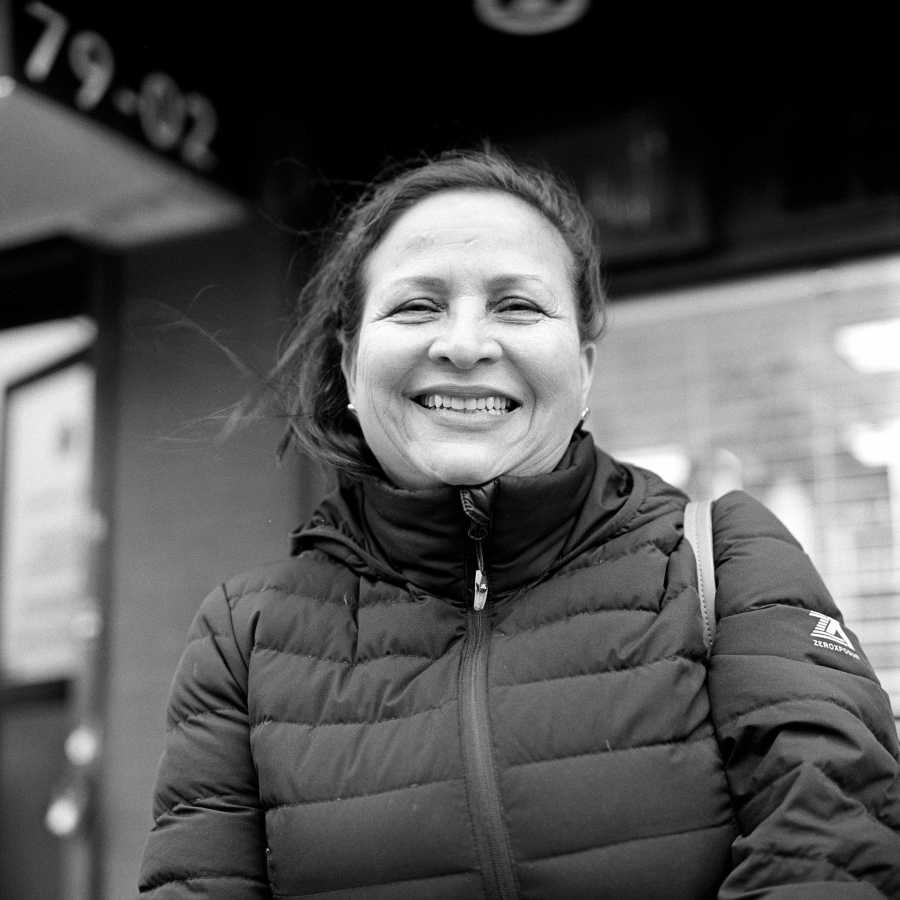 Her friend, the owner of the salon, told her I was photographing people in Jackson Heights and asked her to let me take her portrait. She gave a big smile the whole time.