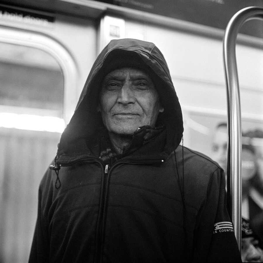 I met him on the 7 train on my way back to Manhattan. He asked about my camera and said yes to a portrait because he said he wanted to make everyone a little bit happier every day.