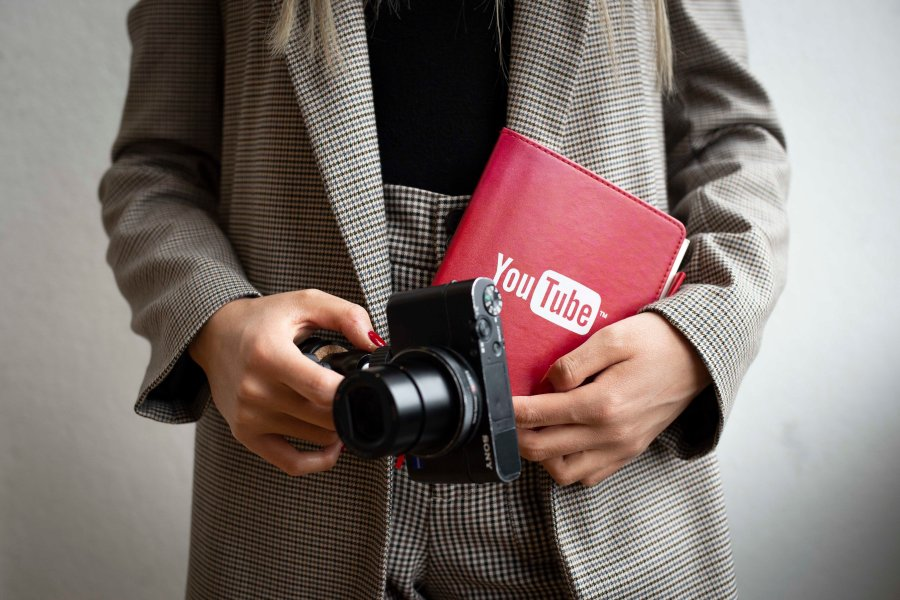Steinhardt sophomore Ainura Kudaibergen holds her vlog camera and a YouTube-branded notebook, which she fills with video ideas. She has been posting to YouTube since 2012. (Photo by Katie Peurrung)