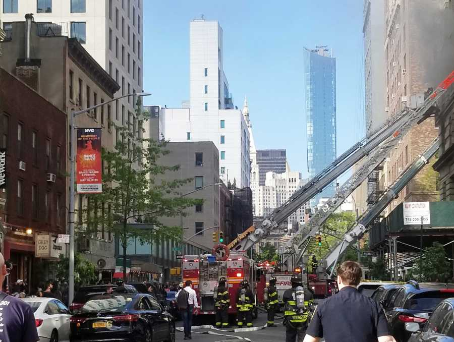 A fire has broken out in a building on East 12th Street and University Place. (Staff Photo by Min Ji Kim)
