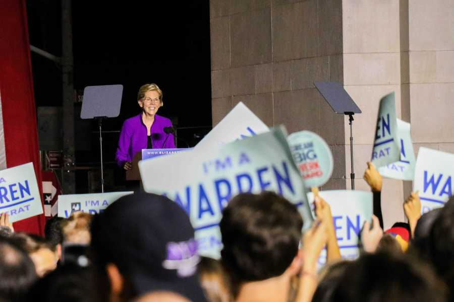 Elizabeth Warren speaks to a crowd of supporters holding 'I'm a Warren Democrat' signs. (Photo by Ishaan Parmar)