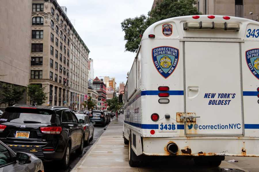 A truck bearing the Correction Department of New York logo is parked near iconic Chinatown buildings. (Staff Photo by Marva Shi)