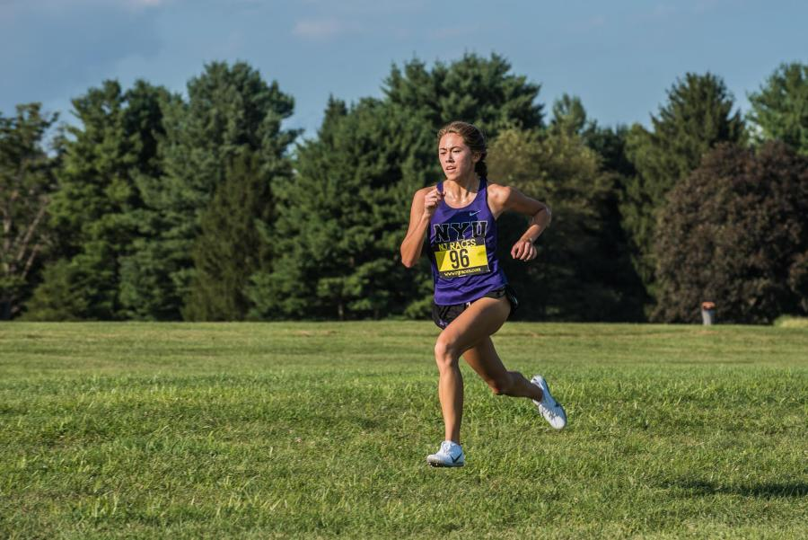First-year Siena Moran has been the top NYU finisher at all three meets this fall, leading the Violets to a ninth-place regional ranking. (Staff Photo by Sam Klein)