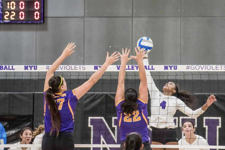 Nazzarine+Waldon+of+NYU+Women%E2%80%99s+Volleyball+spikes+the+ball+against+Hunter+College.+%28Staff+Photo+by+Sam+Klein%29