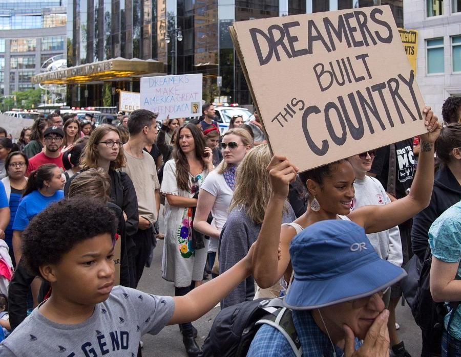 People speak out in support of DACA in New York City. (Via Wikimedia)