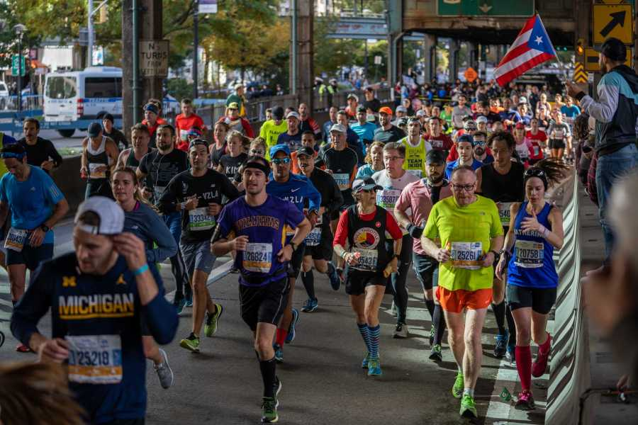 Runners race through Queens as part of the 2019 New York City Marathon. (Photo by Tomer Keysar)