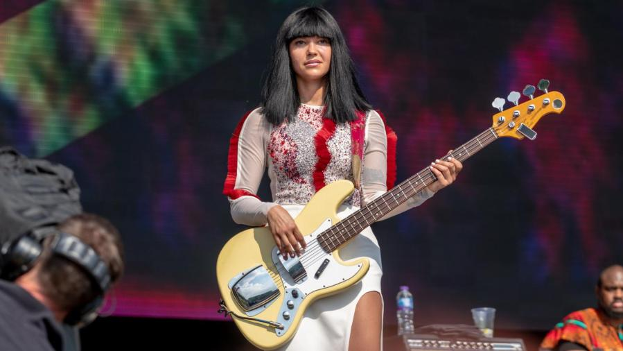 Laura Lee on bass with Houston band Khruangbin, including Mark Speer on guitar, and Donald Ray